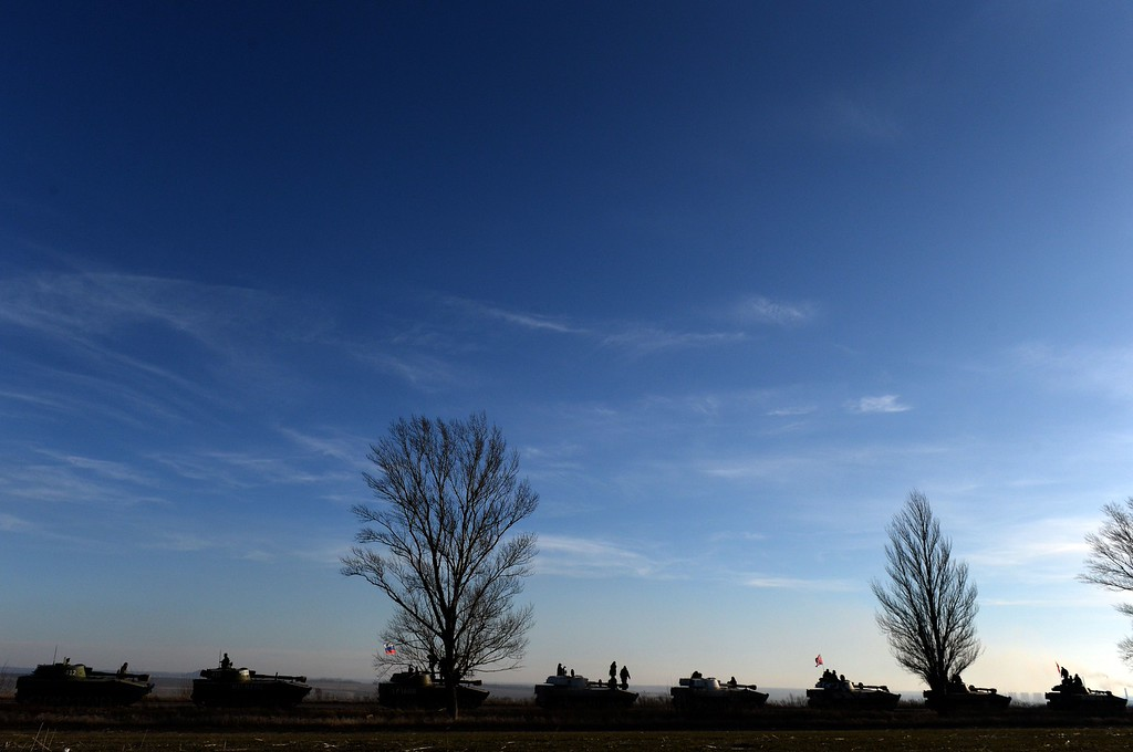 . A convoy of Pro-Russian militants in 2S1 Gvozdikas (122-mm self-propelled howitzers) takes a break as they move from the frontline near the eastern Ukrainian city of Starobeshevo in Donetsk region, on February 25, 2015.  France, Germany, Russia and Ukraine called on February 24 for a total ceasefire in eastern Ukraine as London announced it was sending troops to train government forces fighting pro-Russian separatists in eastern Ukraine. VASILY MAXIMOV/AFP/Getty Images