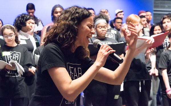04/23/18 Wesley Bunnell | Staff Broadway star Mandy Gonzalez signs along with students from New Britain High School, CCSU and CREC on Monday at New Britain High School during a special workshop. The workshop titled Broadway on Mill Street was a partnership with CCSU, the Ana Grace Project and CSDNB and CREC. Gonzalez is known for portraying Nina Rosario in the musical In the Heights, Elphaba in Wicked and is currently starting in Hamilton.