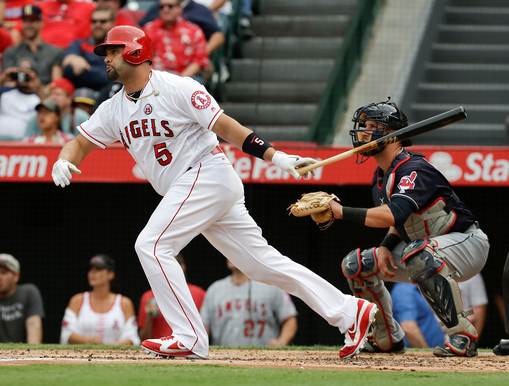 . Los Angeles Angels\' Albert Pujols watches his RBI-double against the Cleveland Indians during the first inning of a baseball game in Anaheim, Calif., Thursday, Sept. 21, 2017. (AP Photo/Chris Carlson)