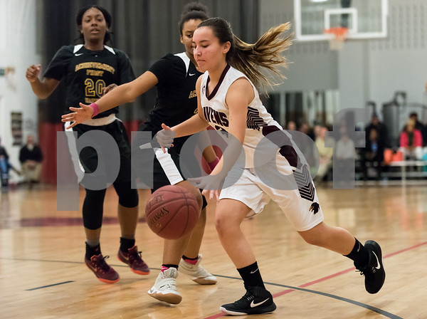 02/06/18 Wesley Bunnell | Staff Innovation girls basketball fell 25-16 to Achievement First on Tuesday night on Senior Night. Kelsey Walicki (3).