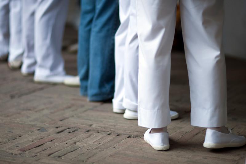 Costaleros (flat bearers) legs. Corpus Christi procession, Seville, Spain, 2009.