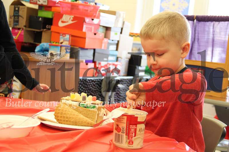 Josh Christy, a kindergartner at  South Butler Primary School worked on his gingerbread house on Friday, December 14, 2018.Photos: Lauryn Halahurich/Butler Eagle