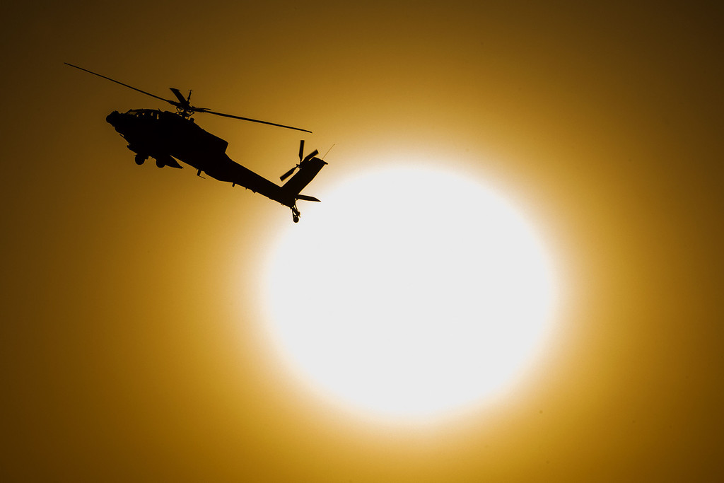 . An Israeli AH-64 Apache longbow helicopter performs during an air show at the graduation ceremony of Israeli air force pilots at the Hatzerim base in the Negev desert, near the southern Israeli city of Beersheva on December 26, 2013. AFP PHOTO/JACK GUEZ/AFP/Getty Images