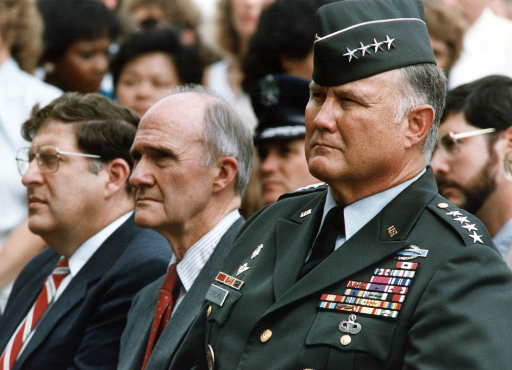 ". General Norm Schwarzkopf (R), central command forces commander for the ""Desert Shield\"" operations, sits besides US National Security Advisor Brent Scowcroft(C) and the White House Chief of Staff John Sununu (L) 15 August 1990, at the Pentagon,Washington, DC as they listen to US President George Bush.  (KEVIN LARKIN/AFP/Getty Images)"