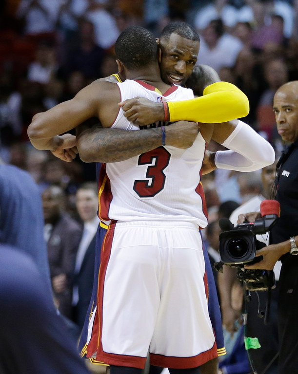 . Cleveland Cavaliers\' LeBron James hugs Miami Heat\'s Dwyane Wade (3) before an NBA basketball game, Monday, March 16, 2015, in Miami. (AP Photo/Lynne Sladky)