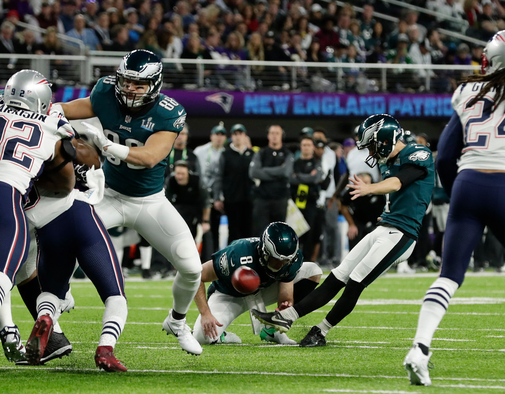. Philadelphia Eagles kicker Jake Elliott (4) kicks a field goal against the New England Patriots, during the first half of the NFL Super Bowl 52 football game Sunday, Feb. 4, 2018, in Minneapolis. Philadelphia Eagles punter Donnie Jones (8), holds. (AP Photo/Frank Franklin II)
