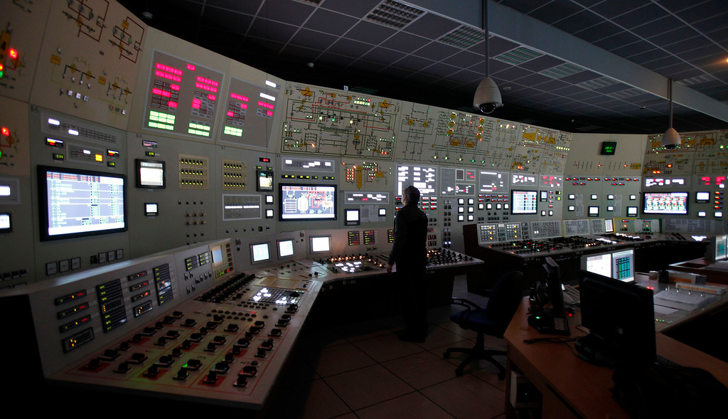 . An employee works during a blackout in the central control room as part of a safety regulations exercise at Nuclear Power Plant Dukovany in Dukovany March 26, 2013.     REUTERS/David W Cerny