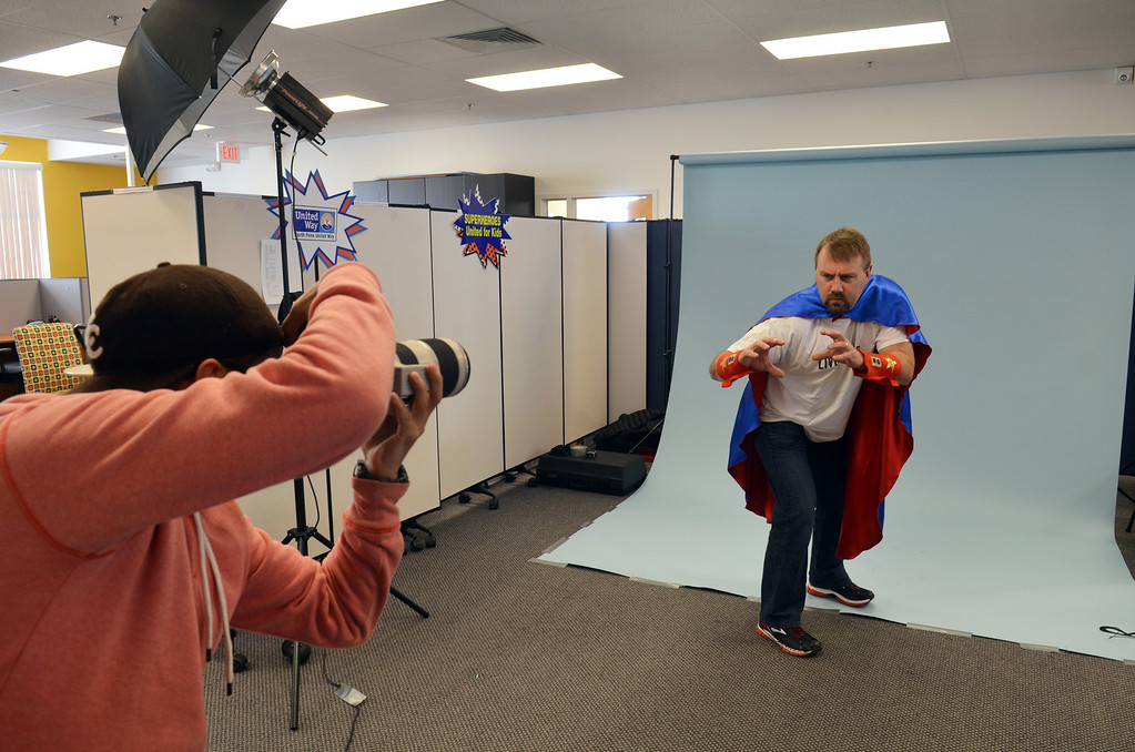 . Josh Rennelss from  Clemens Family Corporation works with photographer Marco Calderon  during a shoot for the North Penn United Way\'s third annual Superheroes United for Kids event.   Finished photographs are used in promotion and will be  displayed during the event in April.   Friday, January 24, 2014.  Photo by Geoff Patton