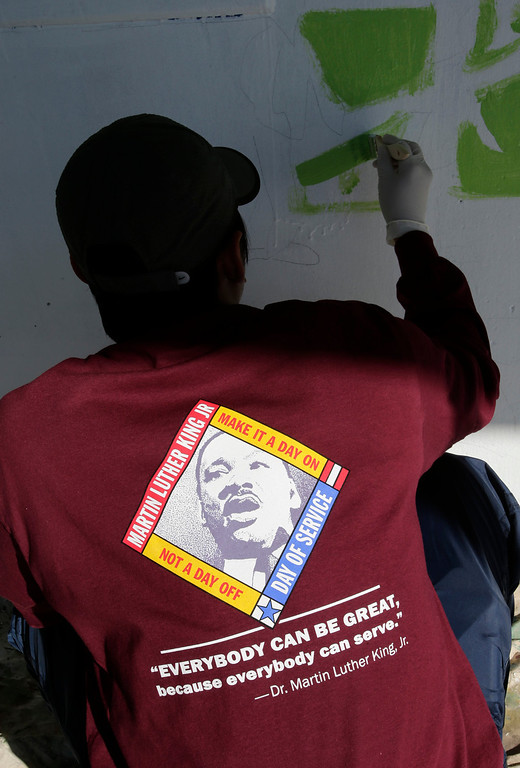 . Kaiser Permanente volunteer, Ronald Quizon, works on a new mural at Ryan Elementary School during a Dr. Martin Luther King Jr. day-of-service activity in San Jose, Calif. on Monday, January 21, 2013.   (Gary Reyes/ Staff)