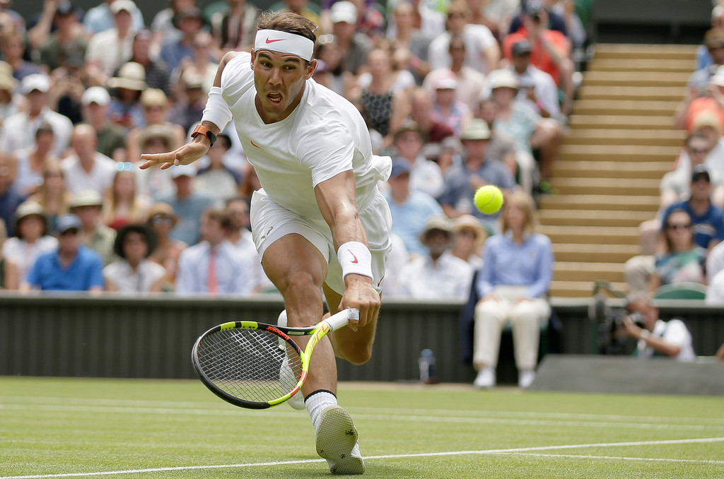 . Rafael Nadal of Spain returns the ball to Mikhail Kukushkin of Kazakhstan, during their men\'s singles match, on the fourth day of the Wimbledon Tennis Championships in London, Thursday July 5, 2018. (AP Photo/Tim Ireland)