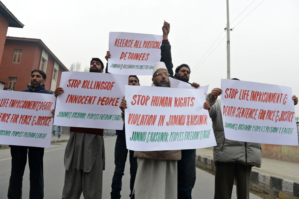 Description of . Jammu and Kashmir Freedom League (JKPFL) activists shout anti-India slogans during a strike held on World Human Rights Day in Srinagar on December 10, 2012. The strike has been called in protest against a court verdict sentencing two Kashmiris to life imprisonment in Srinagar. At least 47,000 people have died as a result of the insurgency in highly militarised Indian Kashmir, according to official count with seperatists putting the toll twice as high.  TAUSEEF MUSTAFA/AFP/Getty Images