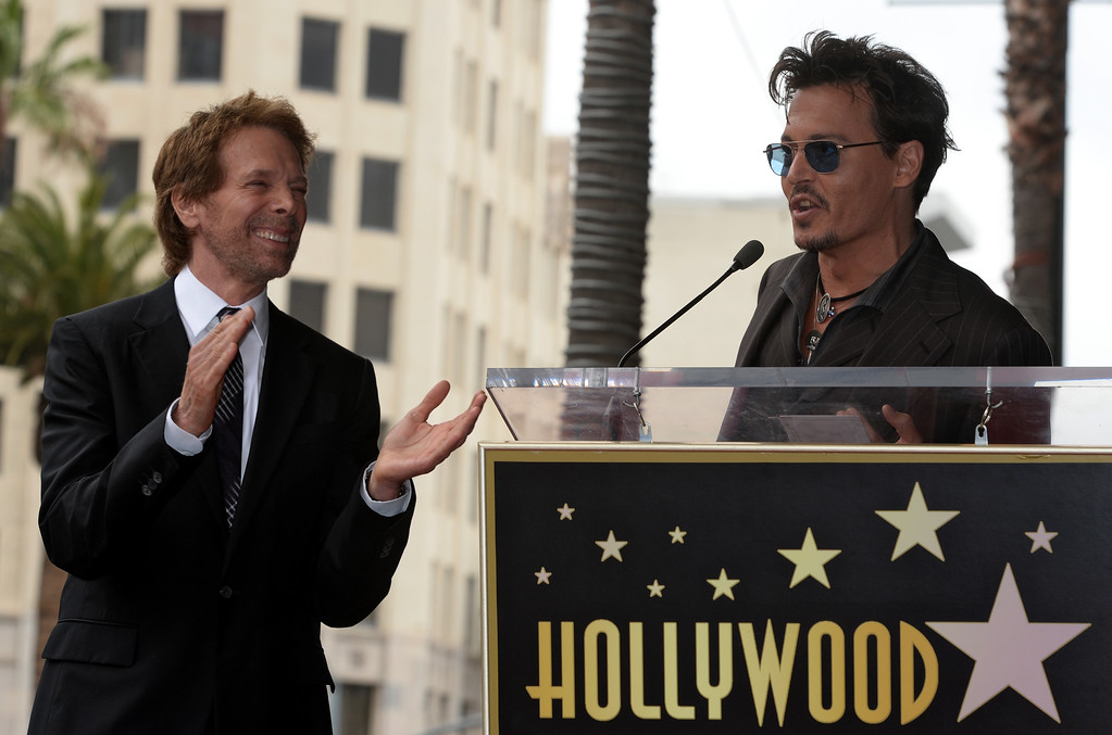 . US actor Johnny Depp (R) introduces US producer Jerry Bruckheimer (L) during a ceremony honoring Bruckheimer with a star on the Hollywood Walk of Fame, in Hollywood, California, USA, 24 June 2013. Bruckheimer received the 2,501st star on the Hollywood Walk of Fame.  EPA/MICHAEL NELSON