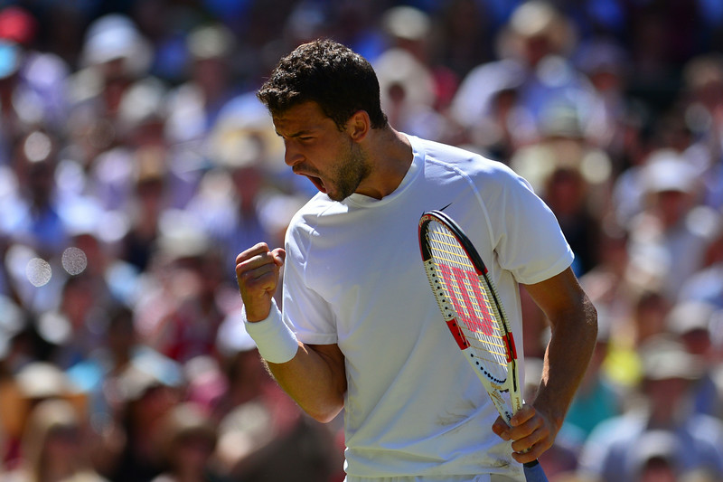. Bulgaria\'s Grigor Dimitrov reacts to winning a point against Serbia\'s Novak Djokovic during their men\'s singles semi-final match on day 11 of  the 2014 Wimbledon Championships at The All England Tennis Club in Wimbledon, southwest London, on July 4, 2014. (CARL COURT/AFP/Getty Images)