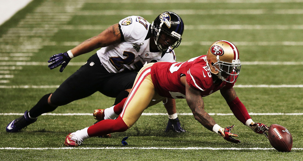 . Tarell Brown #25 of the San Francisco 49ers recovers a fumble by Ray Rice #27 of the Baltimore Ravens in the third quarter during Super Bowl XLVII at the Mercedes-Benz Superdome on February 3, 2013 in New Orleans, Louisiana.  (Photo by Win McNamee/Getty Images)