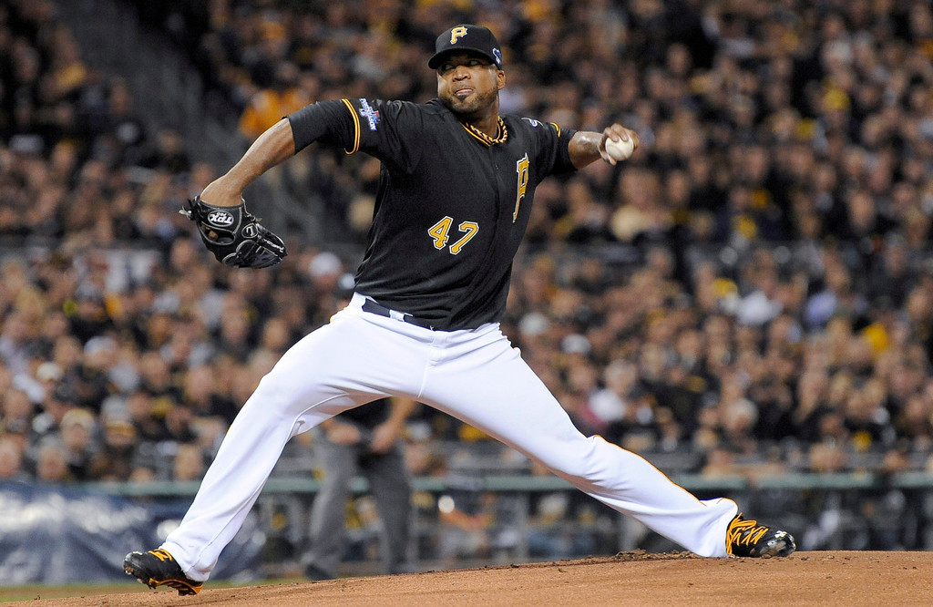 . Pittsburgh Pirates starting pitcher Francisco Liriano (47) throws against the Cincinnati Reds in the first inning of the NL wild-card playoff baseball game Tuesday, Oct. 1, 2013, in Pittsburgh. (AP Photo/Don Wright)
