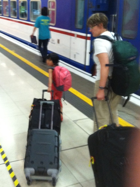 """Tessa isn't afraid of physical effort...pulling two roller suitcases to the train to Hong Kong plus her backpack.  The backpack was not light...she kept adding things until it was stuffed - those were """"her things"""""""