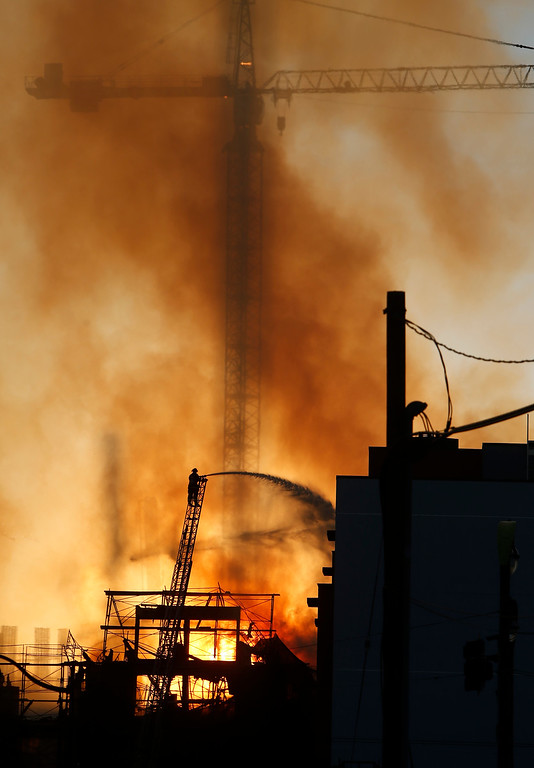 . Firefighters battle a multi-story blaze in a residential building under construction in the Mission Bay neighborhood of San Francisco, Calif., on Tuesday evening, March 11, 2014. (Karl Mondon/Bay Area News Group)
