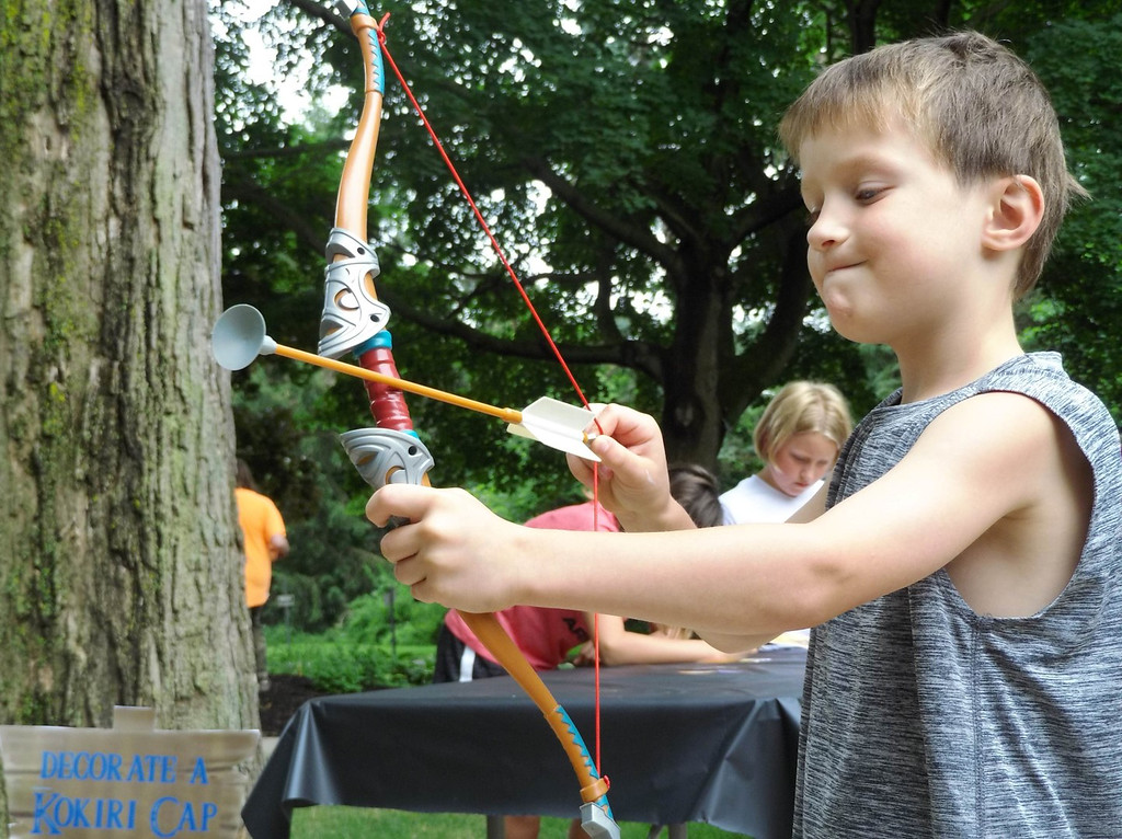 . Philip Pettitt pulls back his arrow during archery practice. (Courtesy Mentor Public Library)