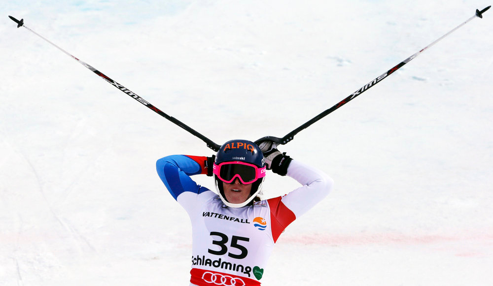 Description of . Michelle Gisin of Switzerland reacts after her second run of the women\'s Slalom race at the World Alpine Skiing Championships in Schladming February 16, 2013.     REUTERS/Ruben Sprich
