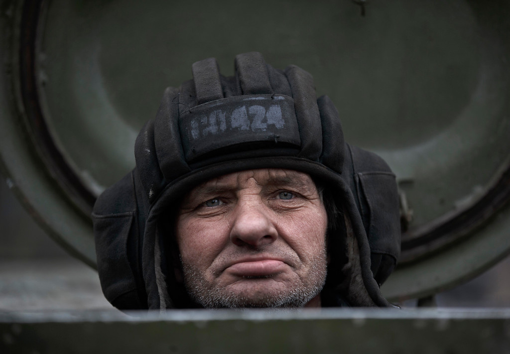 . A Russia-backed separatist fighter sits in a self propelled 152 mm artillery piece, part of a unit moved away from the front lines, in Yelenovka, near Donetsk, Ukraine,Thursday, Feb. 26, 2015. Russia\'s foreign minister is sharply criticizing Ukraine\'s insistence that it won\'t begin pulling back heavy weapons in its fight against separatists in the east until the rebels fully observe a cease-fire. (AP Photo/Vadim Ghirda)