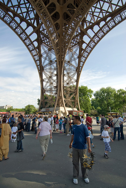 Tourists underneath the Eiffel Tower in Paris, France