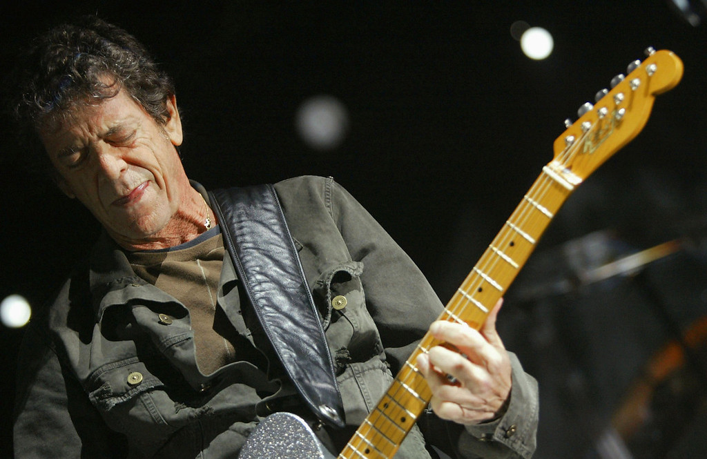 . Musician Lou Reed performs at All Tomorrow\'s Parties at the Queen Mary on November 6, 2004 in Los Angeles, California. The two day music festival was curated by Modest Mouse.  (Photo by Karl Walter/Getty Images)