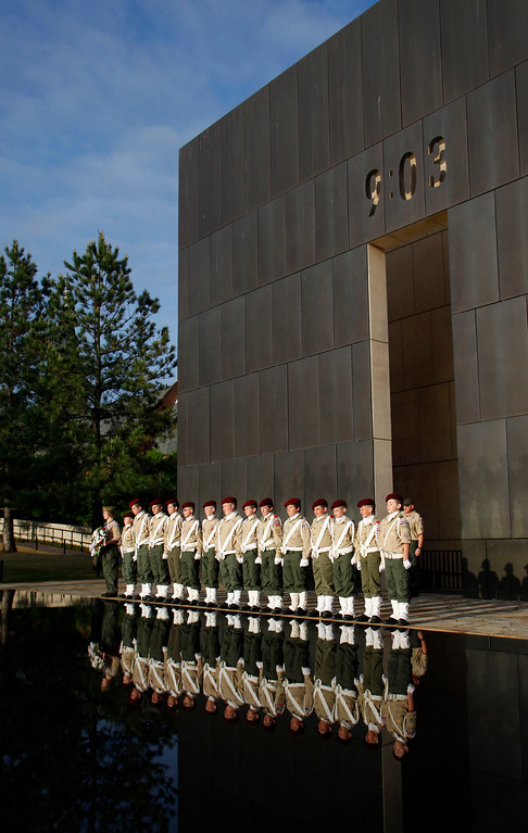 . Members of the Perrin Field Honor Guard Corp, made up of Boy Scouts from Pottsboro, Texas, line up facing the east gate before the 15th anniversary observance ceremony of the Murrah Building bombing April 19, 2010 in Oklahoma City, Oklahoma. Timothy McVeigh detonated a bomb outside the Alfred P. Murrah Federal Building on April 19, 1995, killing 168 people in what was then the largest terrorist attack in United States history. (Photo by Brett Deering/Getty Images)
