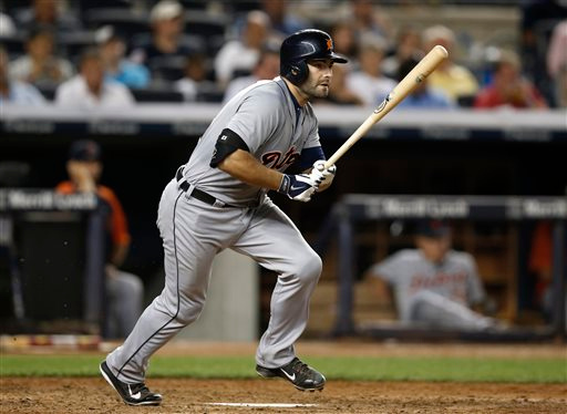 . Detroit Tigers\' Alex Avila watches his seventh-inning single that drive in Victor Martinez in a baseball game against the New York Yankees at Yankee Stadium in New York, Tuesday, Aug. 5, 2014. (AP Photo/Kathy Willens)