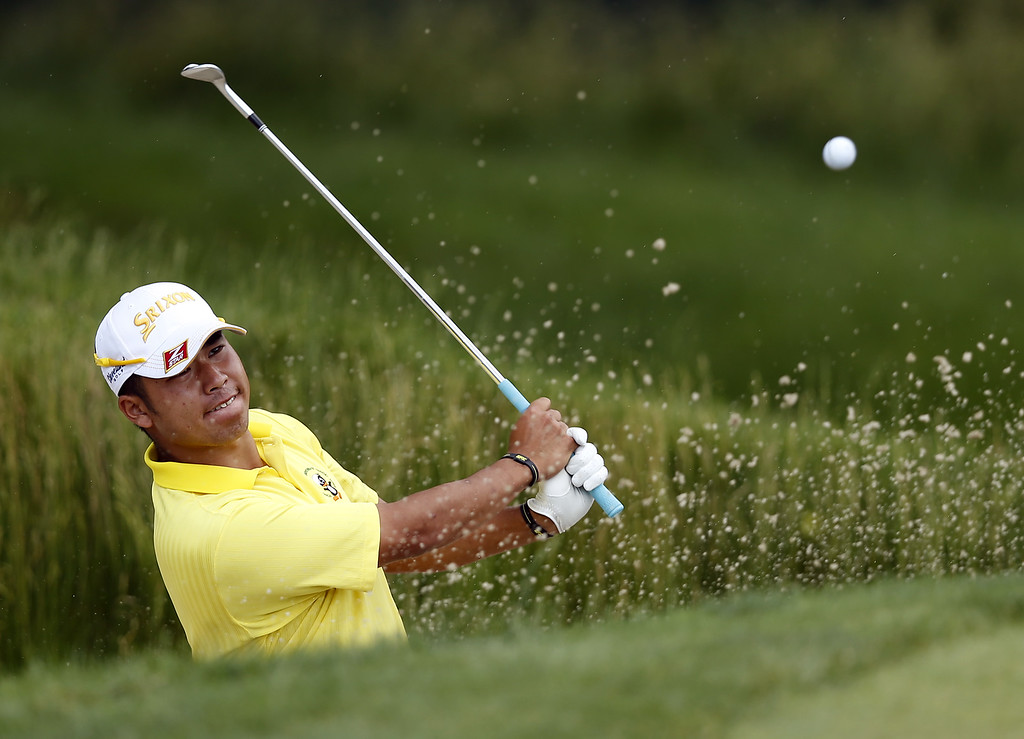 . Hideki Matsuyama of Japan hits a shot from a bunker on the 13th hole during Round Two of the 113th U.S. Open at Merion Golf Club on June 14, 2013 in Ardmore, Pennsylvania.  (Photo by Scott Halleran/Getty Images)