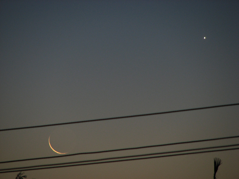 1 Day old crescent Moon (between the power lines) and Venus.
