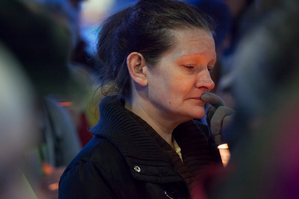 . A woman becomes emotional during a candlelight vigil for mudslide victims on March 25, 2014 in Arlington, Washington. A massive mudslide on March 22 in nearby Oso, Washington killed at least sixteen and left many missing. (Photo by David Ryder/Getty Images)