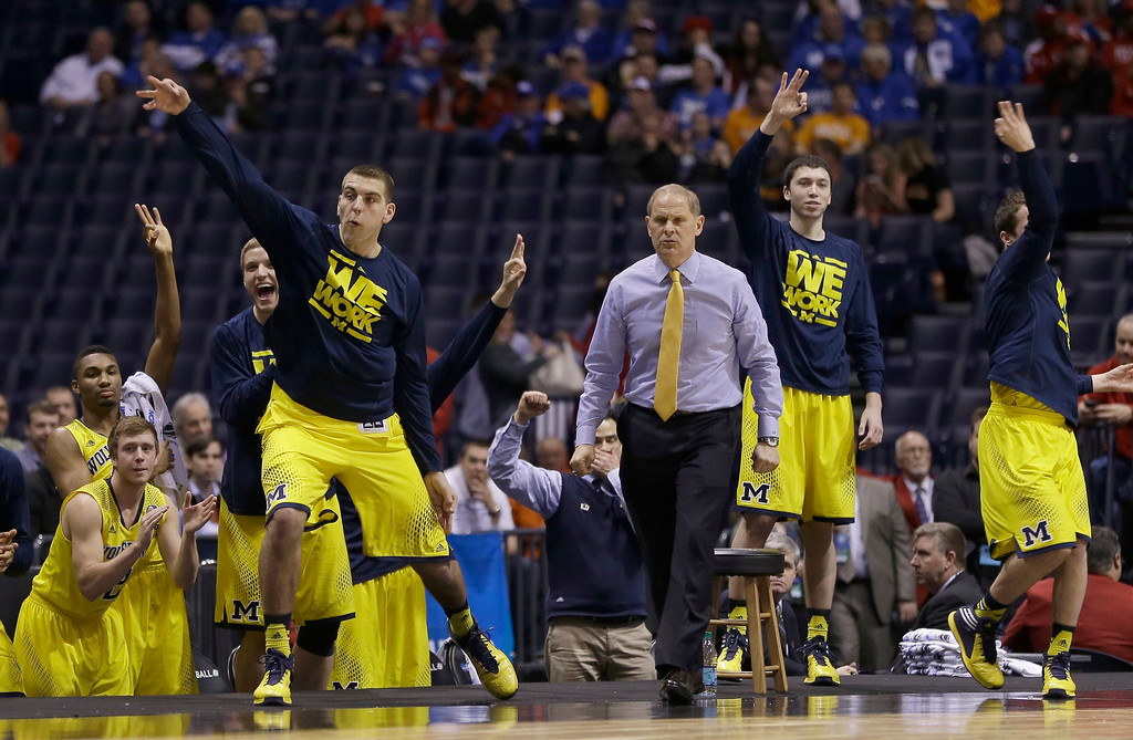 . The Michigan bench reacts during the first half of an NCAA Midwest Regional semifinal college basketball tournament game against the Tennessee Friday, March 28, 2014, in Indianapolis. (AP Photo/David J. Phillip)