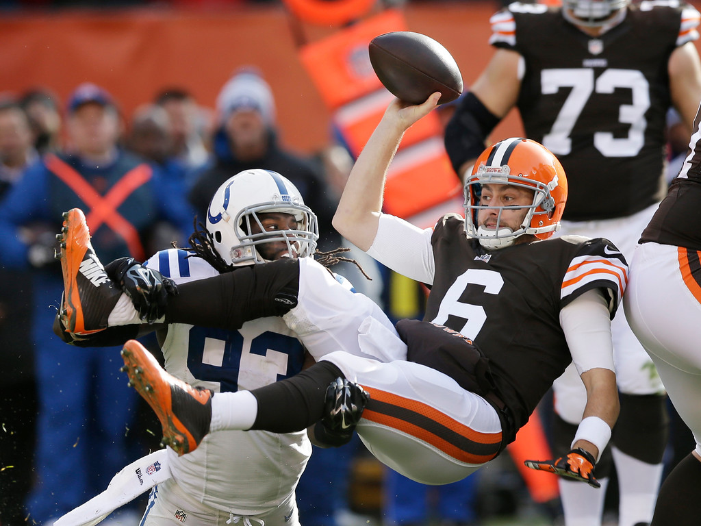 . Cleveland Browns quarterback Brian Hoyer (6) is sacked by Indianapolis Colts outside linebacker Erik Walden (93) in the first quarter of an NFL football game Sunday, Dec. 7, 2014, in Cleveland. (AP Photo/Tony Dejak)