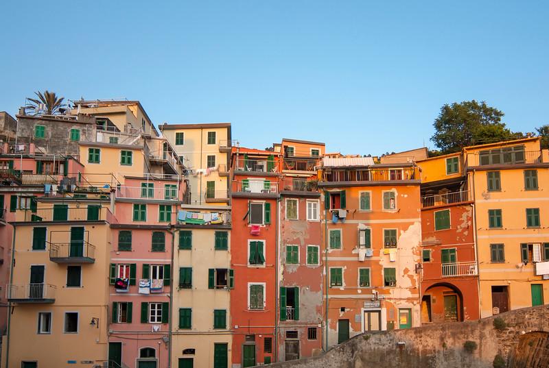 Colourful facades of houses in village of Riomaggiore, Cinque Terre, Italy