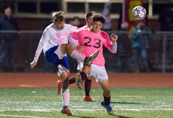 11/04/19 Wesley Bunnell | StaffrrBristol Eastern vs Bristol Central boys soccer on Monday night at Bristol Eastern High School. Bristol Eastern's Adam Borry (5) and Central's David Suazo (23).