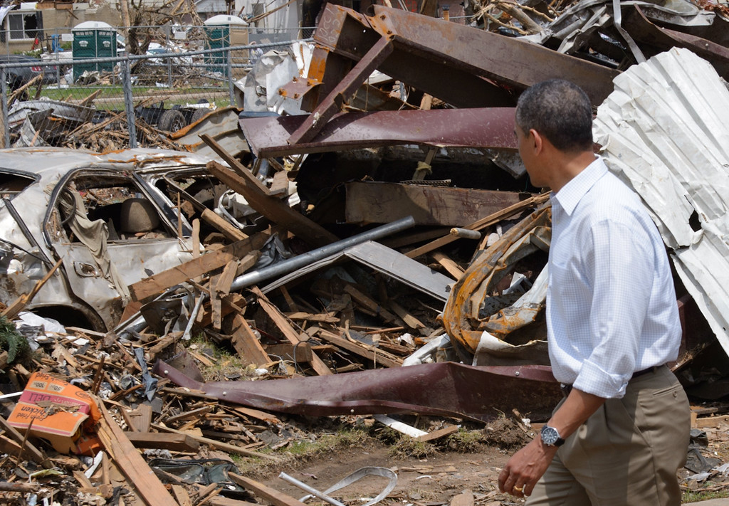 . US President Barack Obama looks at a pile of debris as he visits the tornado affected Plaza Towers Elementary School on May 26, 2013 in Moore, Oklahoma. Obama is in the Oklahoma City area to survey damage from the tornado which struck a week ago and meet with victims and first responders.   MANDEL NGAN/AFP/Getty Images