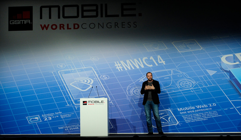 . Co-founder and CEO of Whatsapp Jan Koum speaks during a conference at the Mobile World Congress, the world\'s largest mobile phone trade show in Barcelona, Spain, Monday, Feb. 24, 2014. Expected highlights include major product launches from Samsung and other phone makers, along with a keynote address by Facebook founder and chief executive Mark Zuckerberg. (AP Photo/Manu Fernandez)