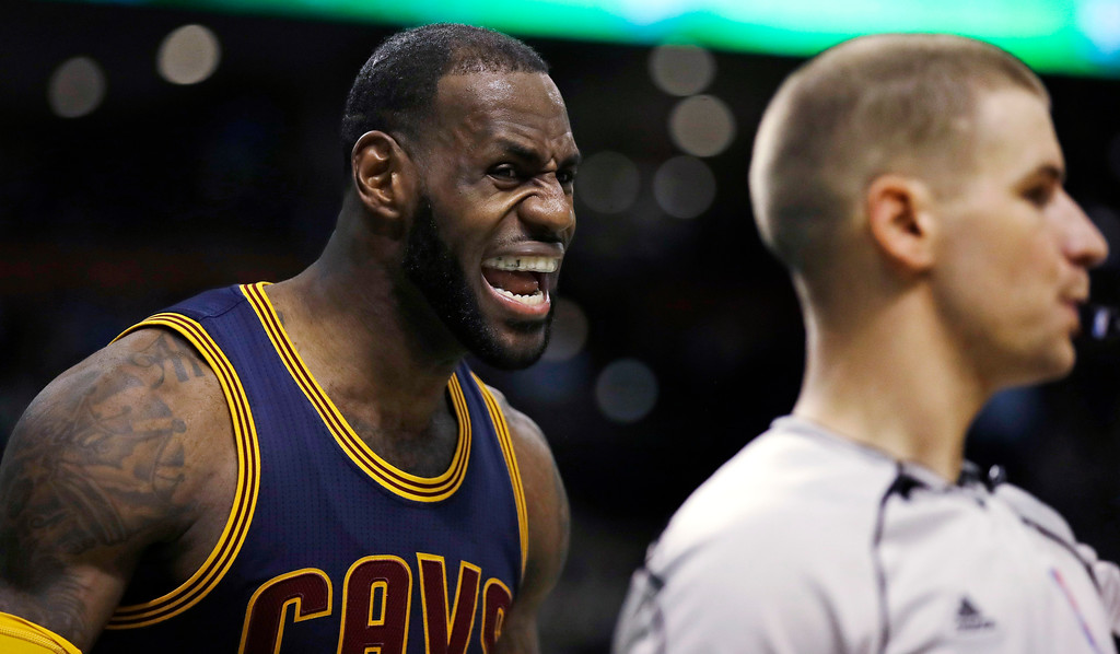 . Cleveland Cavaliers forward LeBron James argues a possession call with referee Tyler Ford, right, during the fourth quarter of the team\'s NBA basketball game against the Boston Celtics in Boston, Wednesday, April 5, 2017. The Cavaliers defeated the Celtics 114-91. (AP Photo/Charles Krupa)
