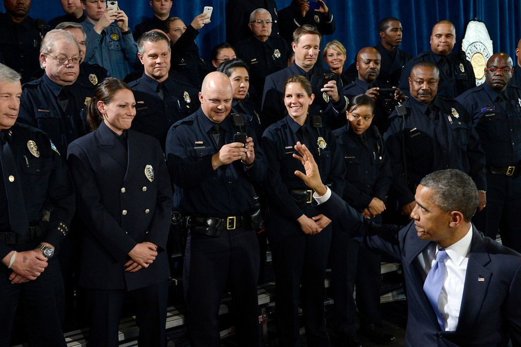 . DENVER, CO. - APRIL 03: President Barack Obama greets law enforcement officers following a forum at the Denver Police Academy in Denver, CO April 03, 2013. In his first trip to Colorado since his re-election, President Obama urged Congress to act more like the state\'s Democratic-controlled legislature and quickly pass stronger gun-control laws. During the meeting with law enforcement officials and community leaders, Obama praised lawmakers and Gov. John Hickenlooper for passing some of the nation\'s strongest gun-control measures after the shootings in Aurora and at a Connecticut elementary school. (Photo By Craig F. Walker/The Denver Post)
