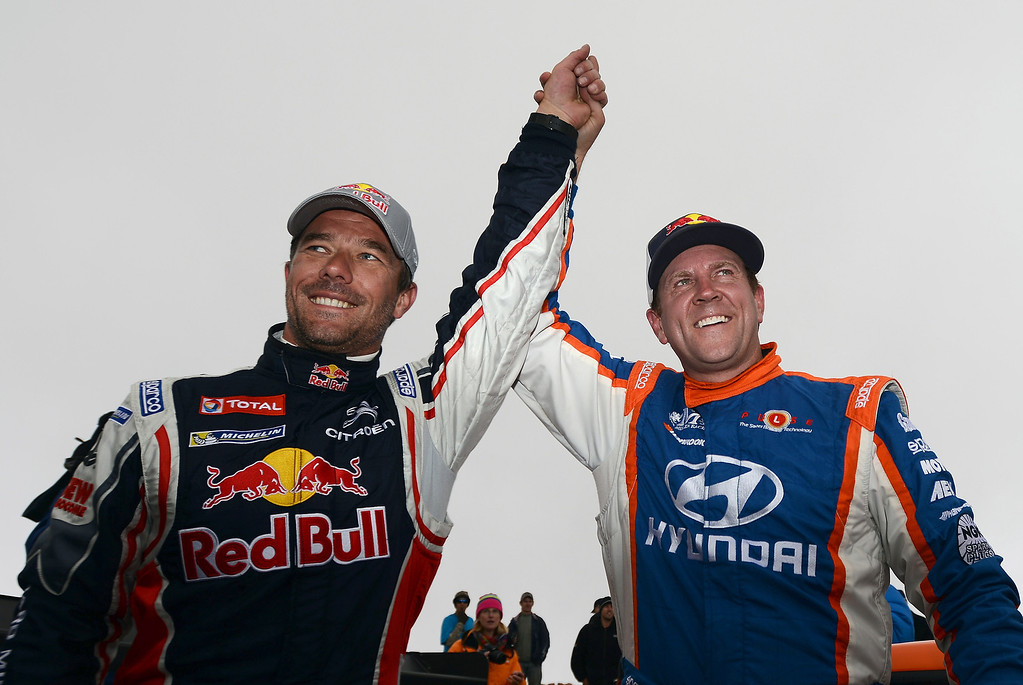 . Sebastien Loeb, of France, driver of the #208 Peugeot 208 T16 Pikes Peak (L), and Rhys Millen of the United States, driver of the #68 Hyundai PM580T celebrate after the Pikes Peak International Hill Climb on June 30, 2013 in Colorado Springs, Colorado. Loeb won the race with a record time of 8:13.878 and Millen finished second in 9:02:192. (Photo by Rainier Ehrhardt/Getty Images)