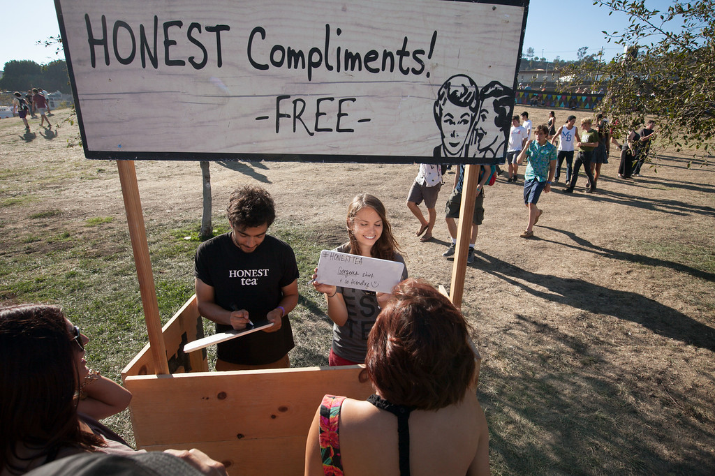 . Bryan Rios and Rebekah Schuh give free honest compliments at the FYF Fest in downtown L.A., Saturday, August 24, 2013. (Michael Owen Baker/L.A. Daily News)