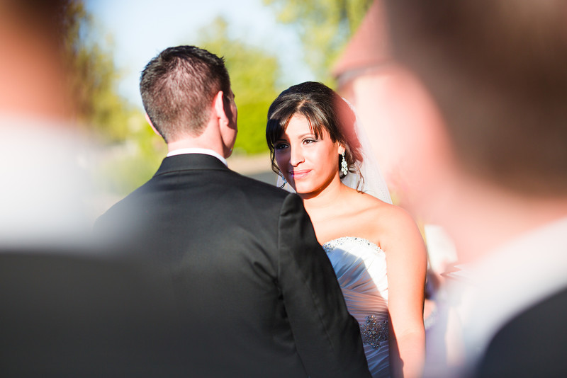 Wedding ceremony on the dock overlooking the river at Prairie Street Brewhouse. Wedding photographer – Ryan Davis Photography – Rockford, Illinois.