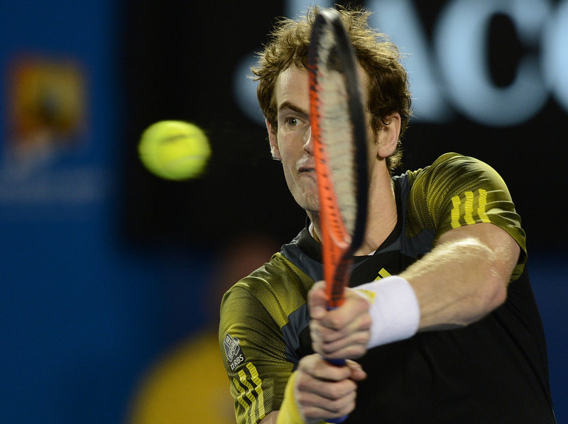 . Britain\'s Andy Murray hits a return against Serbia\'s Novak Djokovic during the men\'s singles final on day 14 of the Australian Open tennis tournament in Melbourne on January 27, 2013.  MANAN VATSYAYANA/AFP/Getty Images
