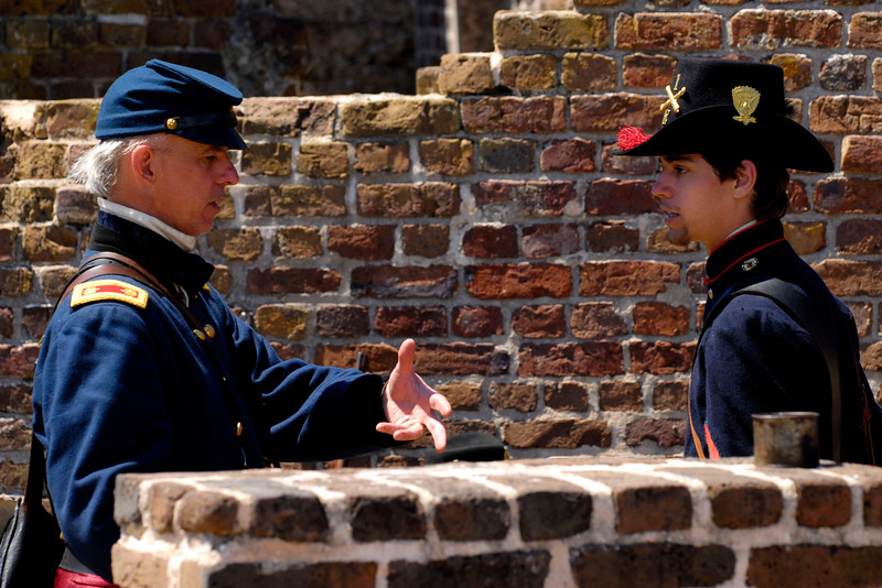 Reenactor Silas Tacket, portraying Major Anderson, explains details to Corporal Ross Collins at Ft. Sumter, located in Charleston Harbor, in Charleston, South Carolina on Wednesday, April 13, 2011. ..The 150th Anniversary of the Firing on Ft. Sumter was commemorated with lectures, performances, demonstrations, and a living history throughout the area on James Island, Charleston, Mt. Pleasant, and Sullivan's Island during the week from April 8-14, 2011. Photo Copyright 2011 Jason Barnette