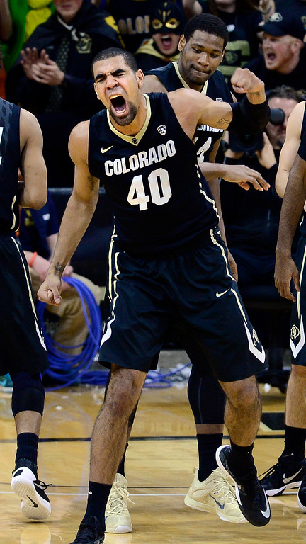 . Colorado forward Josh Scott celebrates after taking a charge during the second half against Arizona in an NCAA college basketball game Wednesday, Feb. 24, 2016, in Boulder, Colo. Colorado won 75-72. (AP Photo/Cliff Grassmick)
