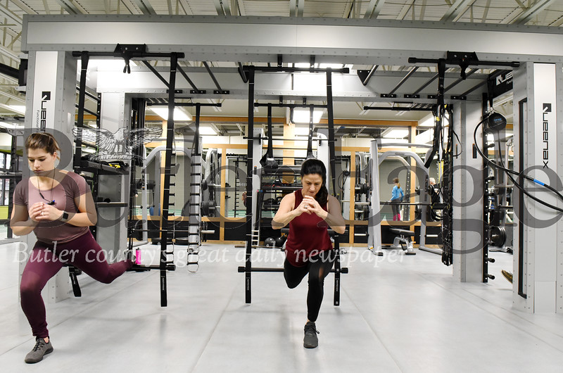 Harold Aughton/Butler Eagle: Trainer Jessica Michel, (left), and group instructor Barb Maxwell workout at the Butler YMCA, Monday, Dec. 2, 2019.