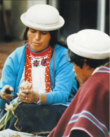 I used a telephoto lens to photograph these onion sellers in Ecuador. Shortly after the next shot I was attacked by 4-5 women who beat me with newspapers and in the frenzy they also cut off one of my cameras and stole it!