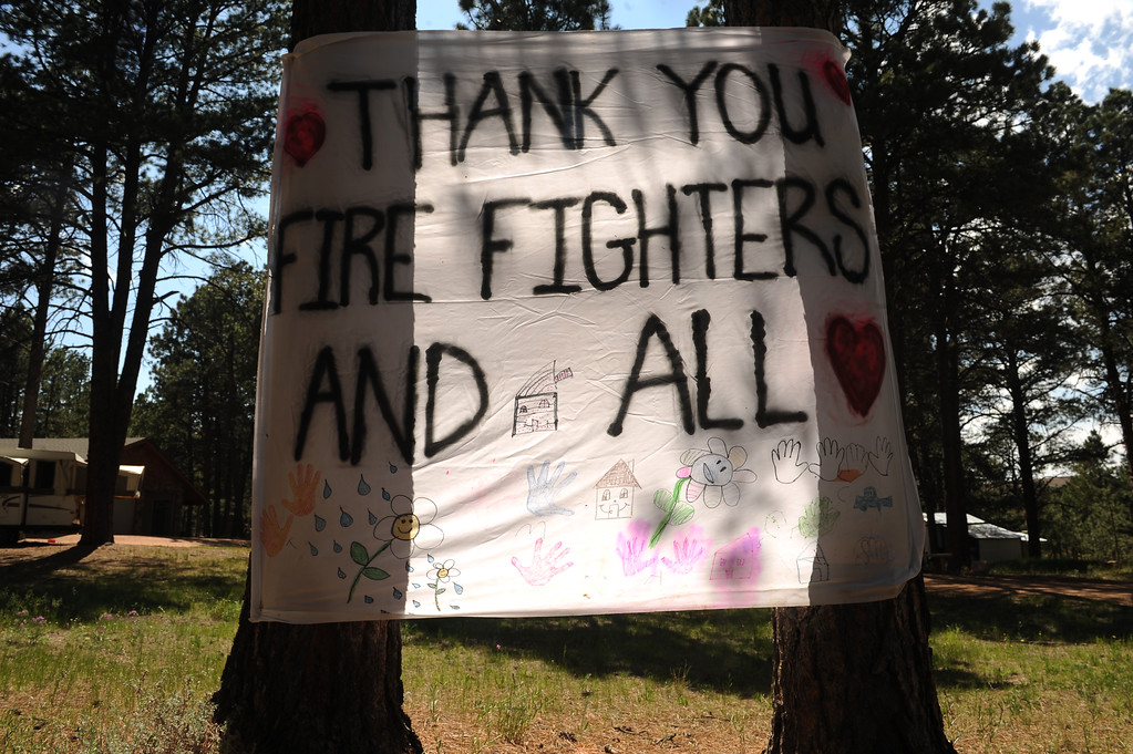 . BLACK FOREST, CO - JUNE 19:  A sign hangs between two trees along Vollmer Road in the Black Forest, CO thanking firefighters for their hard work during the Black Forest Fire on June 19, 2013. The Black Forest Fire stands at 85% containment and more and more homeowners are being allowed back into their homes for a few hours each day. 14, 280 acres have burned and the total number of homes lost increased to 509.  Photo by Helen H. Richardson/The Denver Post)