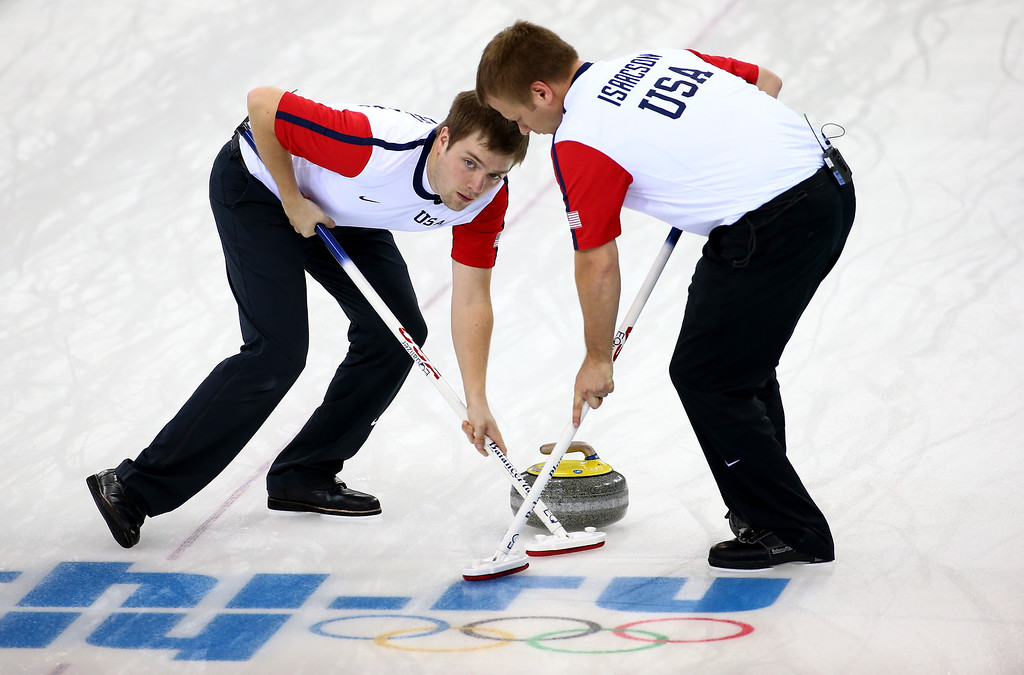 . Jared Zezel and teammate Jeff Isaacson of the USA compete against Switzerland during the Men\'s Curling Round Robin on day ten of the Sochi 2014 Winter Olympics at Ice Cube Curling Center on February 17, 2014 in Sochi, Russia.  (Photo by Streeter Lecka/Getty Images)