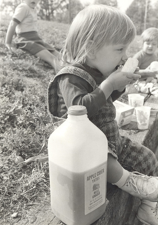 . A youngster enjoys cider and doughnuts outside Yates Cider Mill in 1972. (Photos courtesy of Yates Cider Mill)